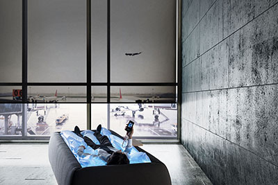 Contemporary open space interior with panoramic windows and cityscape. 3D rendering --- Image by © Sfio Cracho/Corbis